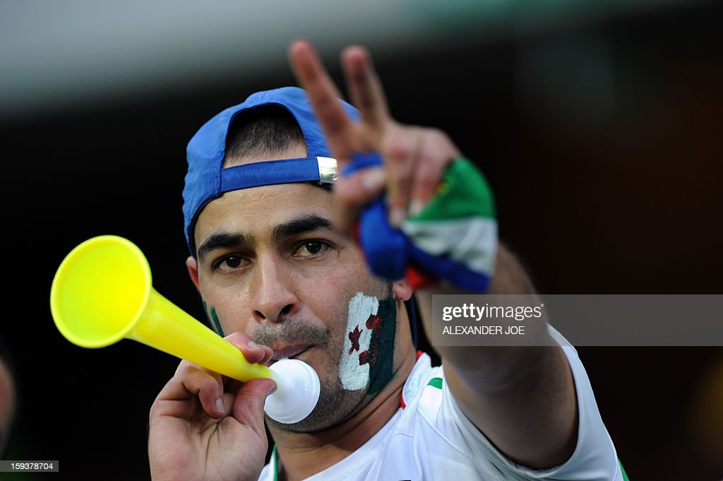 An Algerian fan gestures during a friendly football match between South Africa's Bafana Bafana and Algeria in Soweto on January 12 , 2013, ahead of the 2013 African Cup of nation that will take place in South Africa from January 19 to February 10.