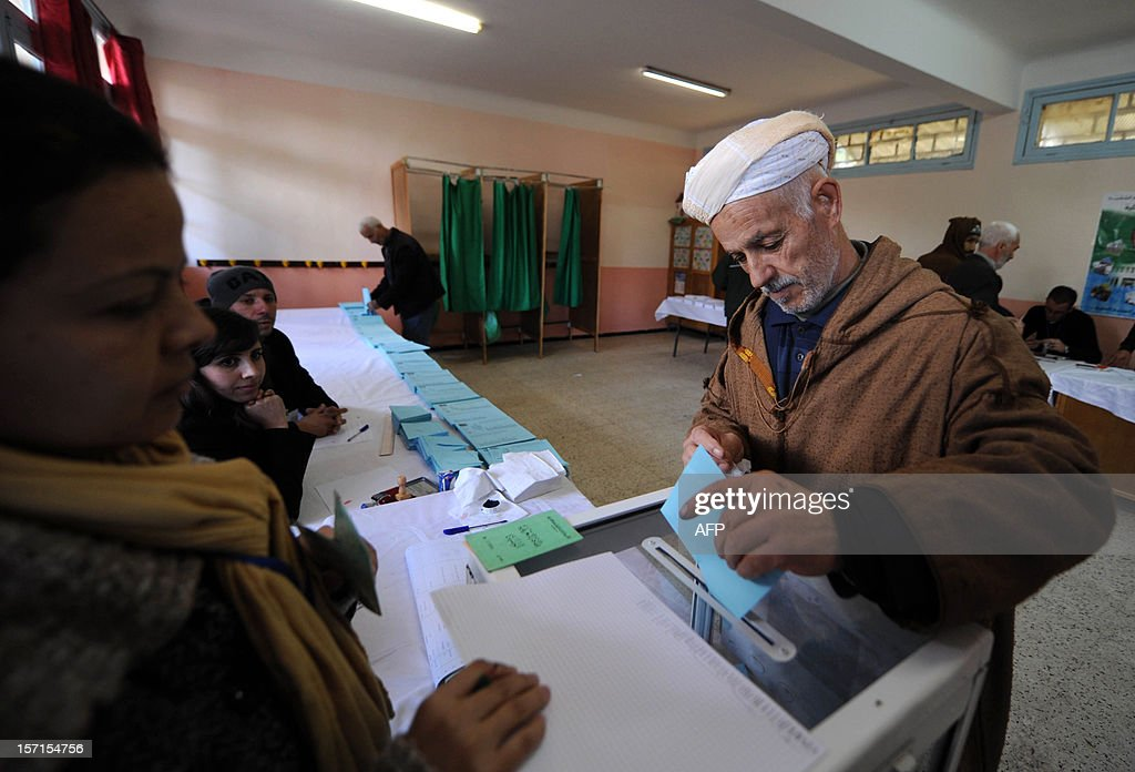 An Algerian man casts his vote at a polling station in Algiers during local elections on November 29, 2012. Algeria's ruling party is eyeing a landslide victory in local elections, with numerous opposition groups warning of fraud in a poll that could struggle to mobilise a disaffected electorate. AFP PHOTO/FAROUK BATICHE