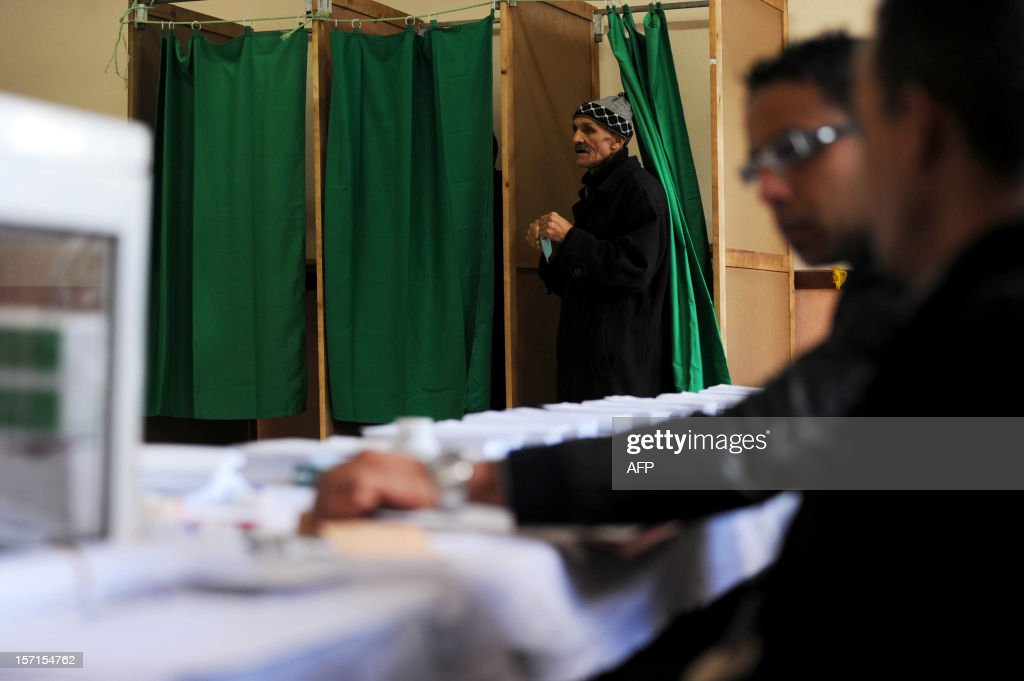 An Algerian man leaves a voting booth before casting his vote at a polling station in Algiers, during local elections on November 29, 2012. Algeria's ruling party is eyeing a landslide victory in local elections, with numerous opposition groups warning of fraud in a poll that could struggle to mobilise a disaffected electorate.