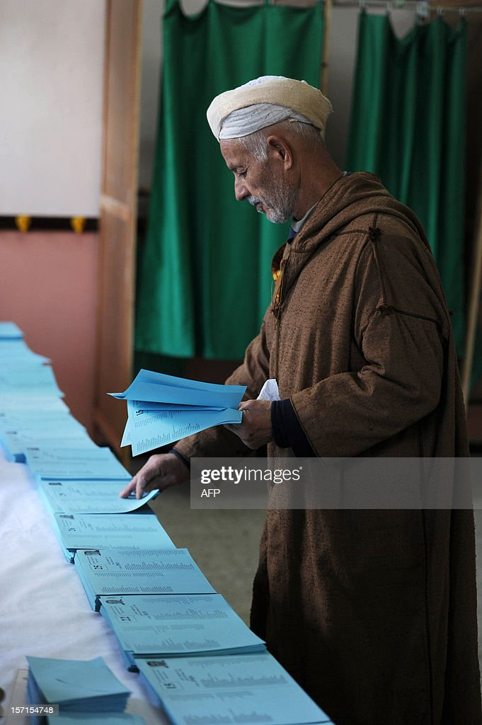 An Algerian man picks ballots before voting at a polling station in Algiers during local elections on November 29, 2012. Algeria's ruling party is eyeing a landslide victory in local elections, with numerous opposition groups warning of fraud in a poll that could struggle to mobilise a disaffected electorate.