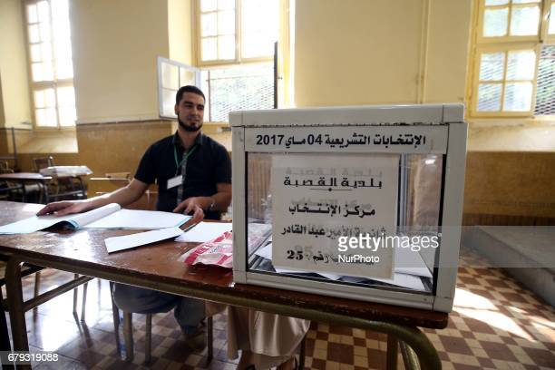 An Algerian man prepares to cast at a polling station in Algiers Algeria on May 4 2017 during parliamentary elections Algerians voted for a new...