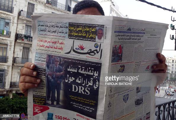 An Algerian man reads a local newspaper EnNahar bearing a picture for the first time of former Algerian intelligence chief General Mohamed Mediene...