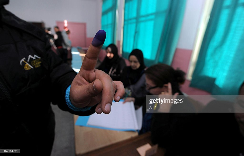 An Algerian man shows his ink stained finger after voting at a polling station in Algiers, during local elections on November 29, 2012. Algeria's ruling party is eyeing a landslide victory in local elections, with numerous opposition groups warning of fraud in a poll that could struggle to mobilise a disaffected electorate. AFP PHOTO/FAROUK BATICHE