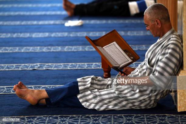 An Algerian Muslim reads the Koran in a mosque in Boufarik Algeria on The tenth day of the holy Muslim month of Ramadan of the year Hijri From 1438