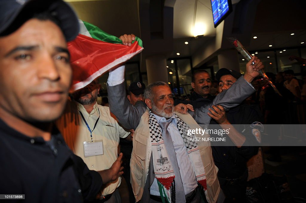 An Algerian pro-Palestinian activist, who was detained aboard the Gaza-bound aid flotilla raided by Israel on May 31, 2010, waves to greet supporters as he arrives at Algiers International airport early on June 3, 2010. Thirty two Algerian activists deported from Israel arrived in Algiers following their release from arrest by Israel after its deadly raid on an aid flotilla headed for Gaza.