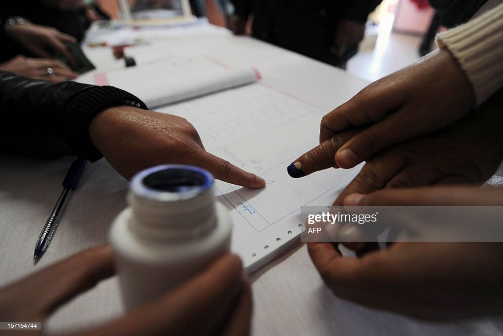 An Algerian puts his finger print on an election document after voting at a polling station in Algiers, during local elections on November 29, 2012. Algeria's ruling party is eyeing a landslide victory in local elections, with numerous opposition groups warning of fraud in a poll that could struggle to mobilise a disaffected electorate.