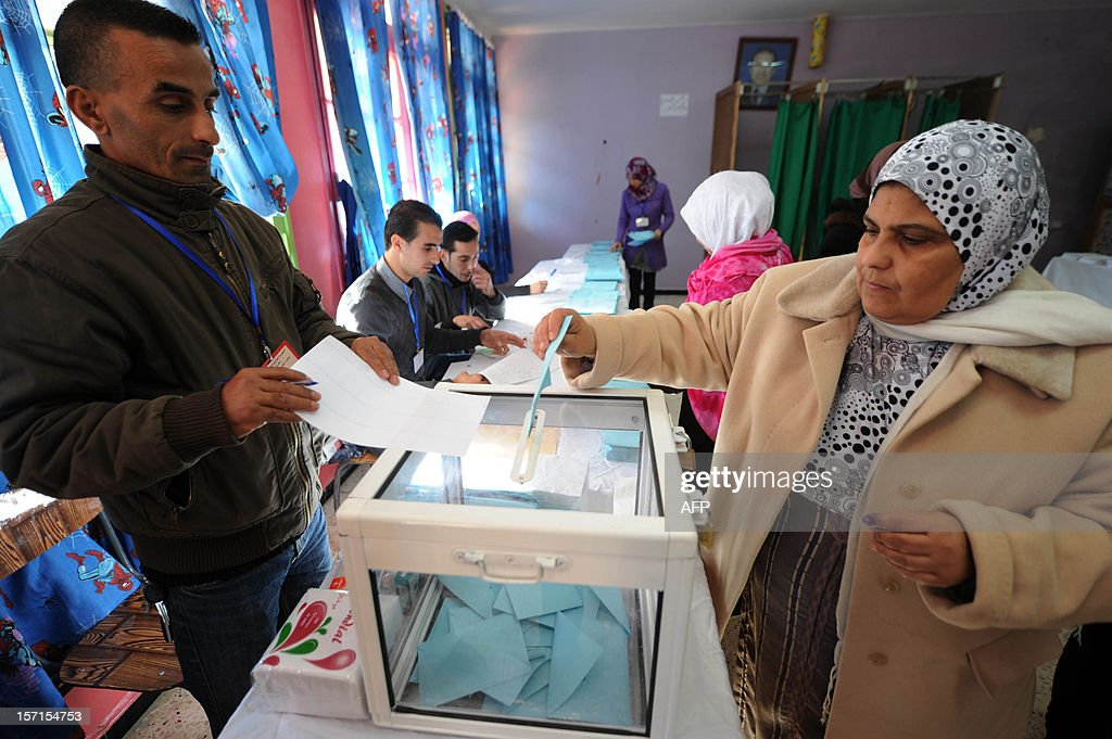 An Algerian woman casts her vote at a polling station in Algiers during local elections on November 29, 2012. Algeria's ruling party is eyeing a landslide victory in local elections, with numerous opposition groups warning of fraud in a poll that could struggle to mobilise a disaffected electorate. AFP PHOTO/FAROUK BATICHE