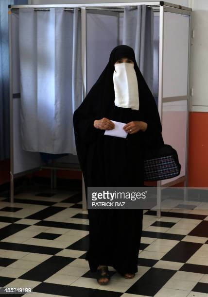 An Algerian woman prepares to cast her vote in the presidential elections at a polling station in Algiers on April 17 2014 Algeria's incumbent...