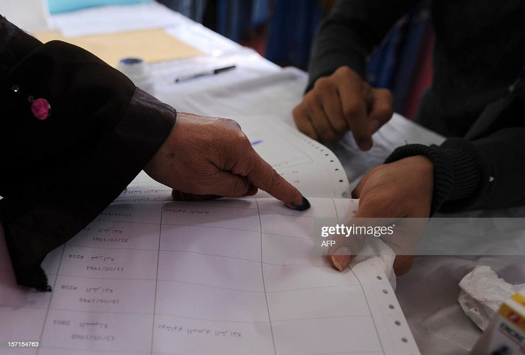 An Algerian woman puts her finger print on an election document after casting her ballot at a polling station in Algiers, during local elections on November 29, 2012. Algeria's ruling party is eyeing a landslide victory in local elections, with numerous opposition groups warning of fraud in a poll that could struggle to mobilise a disaffected electorate.