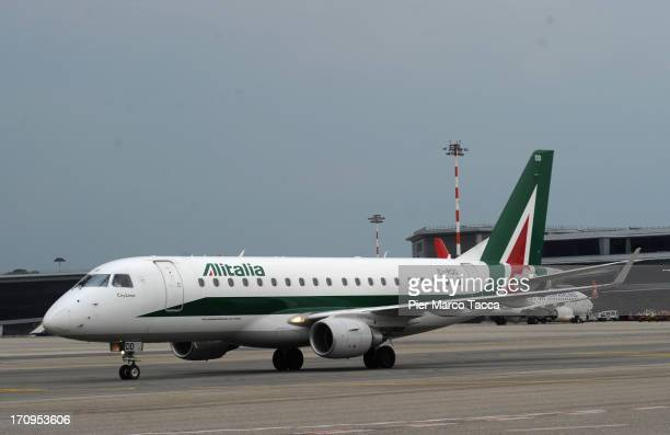 An Alitalia airplane is shown at Malpensa airport on June 20 2013 in Milan Italy Malpensa is one of the main international European airports with...