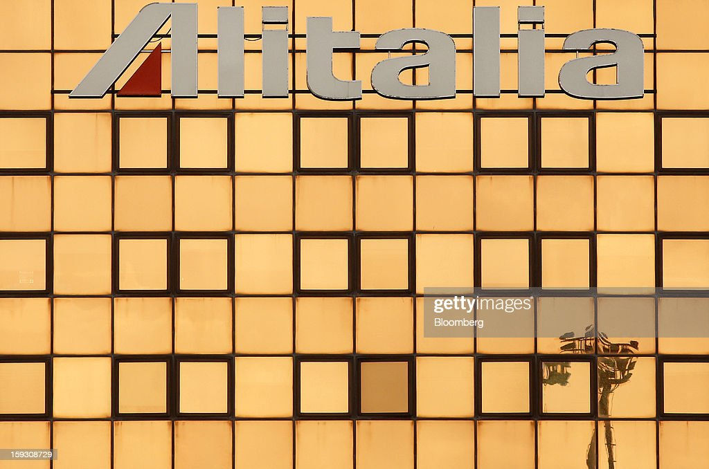 An Alitalia SpA logo sits on the company's offices at Fiumicino airport in Rome, Italy, on Friday, Jan. 11, 2013. Former Italian Prime Minister Silvio Berlusconi's economic adviser said the European debt crisis has left his country's companies vulnerable to takeovers by foreign rivals and urged the government to prepare defences. Photographer: Alessia Pierdomenico/Bloomberg via Getty Images