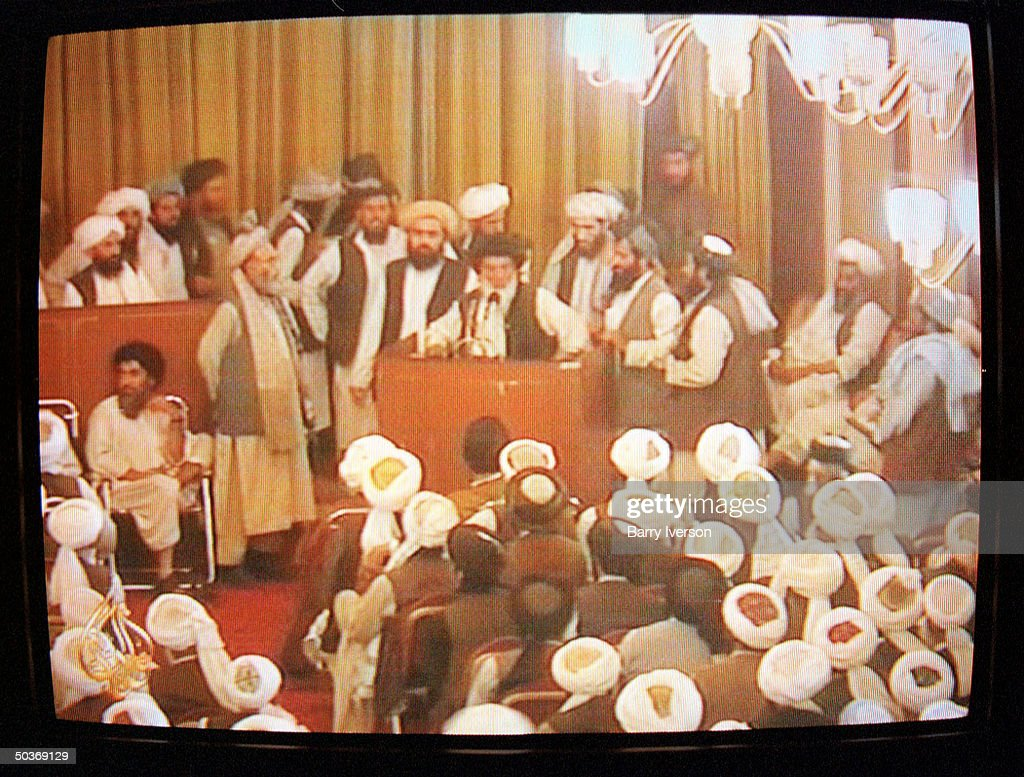 An Al-Jazeera TV freeze frame of Afghanistan's Islamic clergy (Ulema) meeting to debate the status of Osama Bin Laden after the US demanded that the ruling Taliban hand over the alleged terrorist mastermind behind the September 11 attacks on US soil.