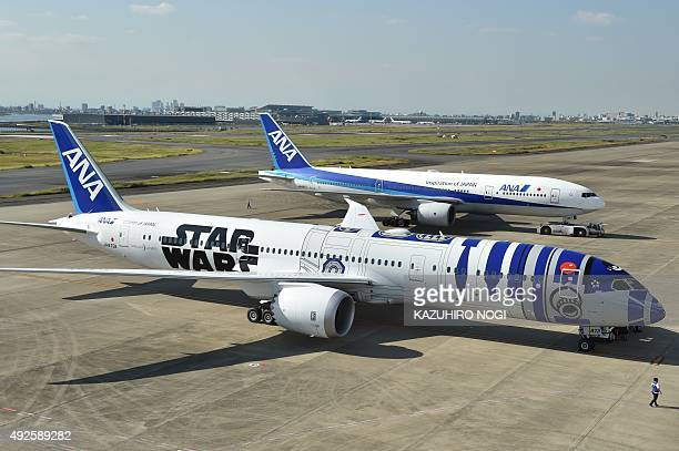An All Nippon Airways Boeing 7879 aircraft in the livery of Star Wars droid character R2D2 is seen on the tarmac at Tokyo's Haneda airport on October...