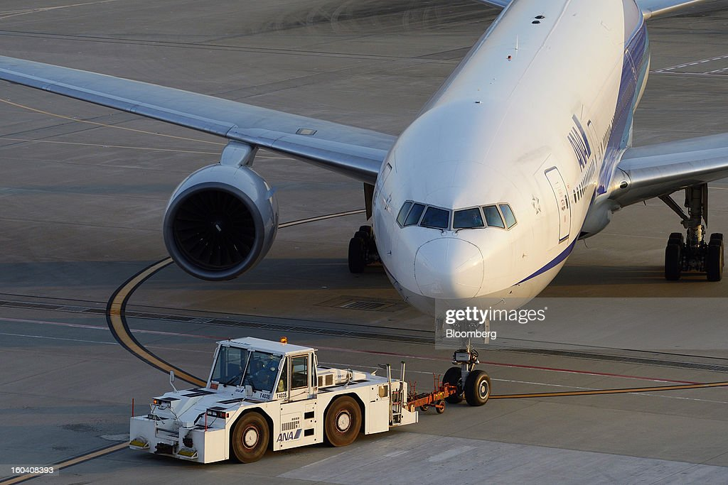 An All Nippon Airways Co. (ANA) aircraft is towed on the tarmac at Haneda Airport in Tokyo, Japan, on Wednesday, Jan. 30, 2013. ANA has canceled a total of 784 flights, affecting 74,200 passengers through Feb. 12, since a Jan. 16 incident that led to the global grounding of Boeing Co. 787s, according to figures from the company. Photographer: Akio Kon/Bloomberg via Getty Images