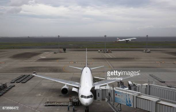An All Nippon Airways Co aircraft stands parked at Haneda Airport in Tokyo Japan on Wednesday April 26 2017 ANA is scheduled to release Fourthquarter...
