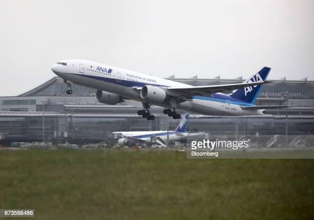An All Nippon Airways Co aircraft takes off at Haneda Airport in Tokyo Japan on Wednesday April 26 2017 ANA is scheduled to release Fourthquarter...