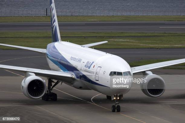 An All Nippon Airways Co aircraft taxis at Haneda Airport in Tokyo Japan on Wednesday April 26 2017 ANA is scheduled to release Fourthquarter...