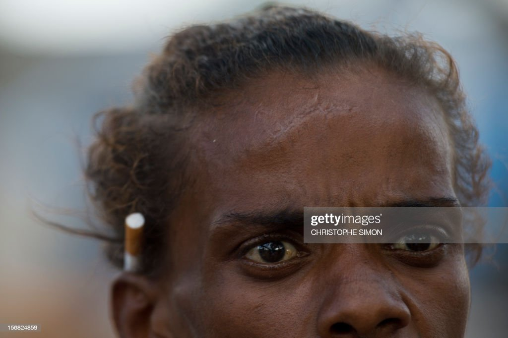 An alleged crack addict woman living in the street photographed during a police-municipality joint operation to retire crack addicts from the streets in the vicinity of the Parque Uniao slum in Rio de Janeiro, Brazil, on November 22, 2012. AFP PHOTO/Christophe Simon