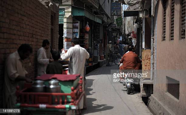 An alleyside bazaar is pictured in the old town section of Multan on March 17 2012 Multan one of the oldest cities in the Asian subcontinent and...