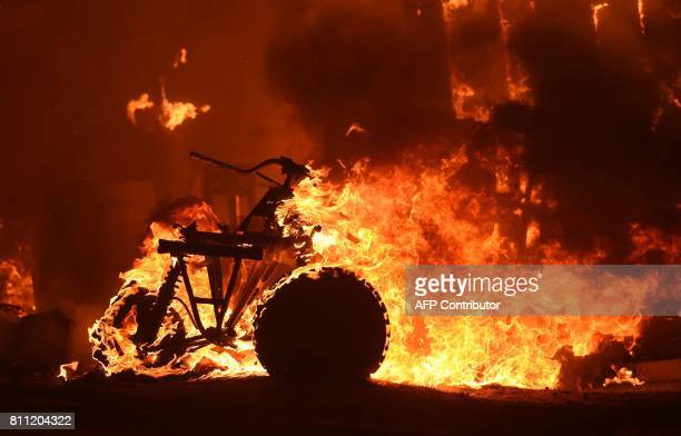 An allterrain vehicle burns during a wildfire in a residential area near Oroville California on July 9 2017 The first major wildfires after the end...