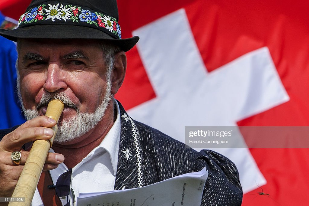 An alphorn player performs on July 28 2013 in Nendaz Switzerland About 150 Alphorn blowers performed together on the last day of the international...