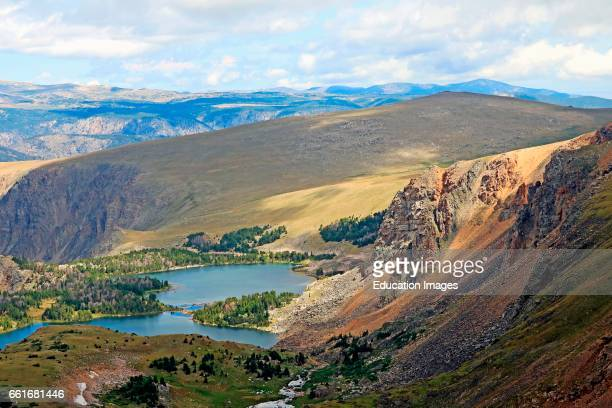 An alpine lake in afternoon shadow in the Bear tooth Mountains of the Shoshone National Forest in far northern Wyoming The Bear tooth Mountains are...