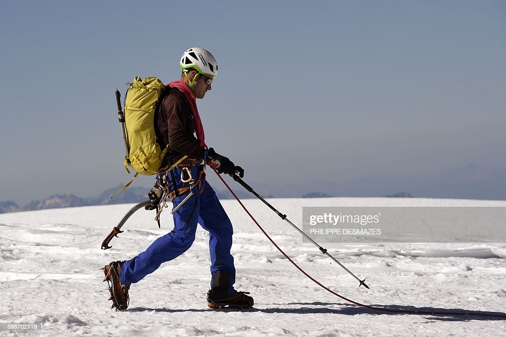 An alpinist walks on August 25 on the normal way for climbing to the MontBlanc peak in Chamonix eastern France / AFP / PHILIPPE DESMAZES