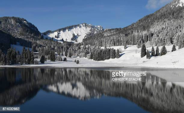 An Alps panorama reflects in the Spitzingsee lake in the small Bavarian village of Spitzingsee in the Alp mountains southern Germany during nice...