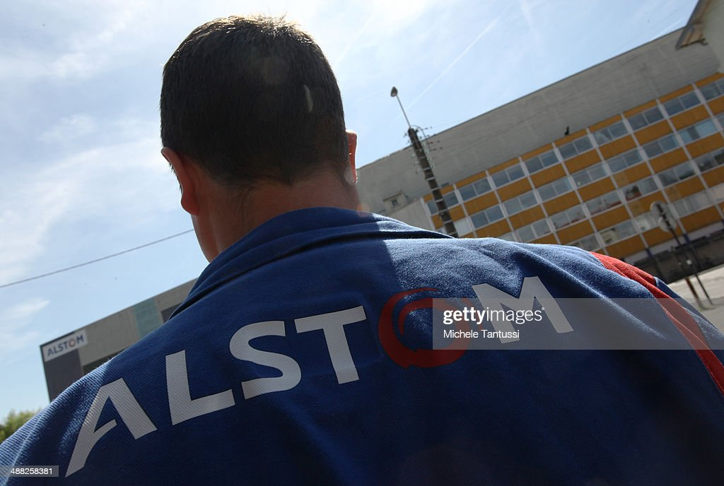 An Alstom S.A. employee stands in front of the main Factory Building on May 5, 2014 in Belfort, France. General Electric is seeking to take over Alstom, one of its main competitors, and so far a counter move by Siemens to buy Alstom instead seems more and more unlikely.