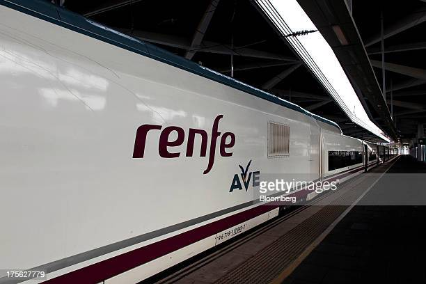An Alta Velocidad Espanola highspeed train operated by Renfe Operadora SC sits alongside a platform at Joaquin Sorolla railway station in Valencia...