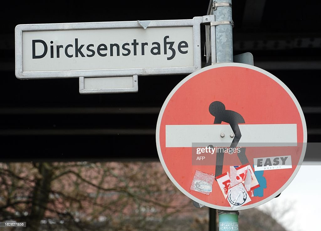 An altered traffic sign by French street artist Clet Abraham is seen in Berlin on February 22, 2013.