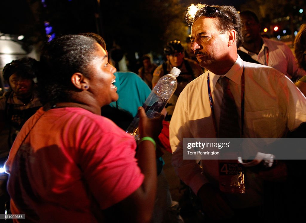 An alternate delegate at the Republican National Convention is confronted by a crowd of protesters after leaving the Tampa Bay Times Forum on August 30, 2012 in Tampa, Florida. The Republican party delegates affirmed Mitt Romney as the party's nominee for president August 28.