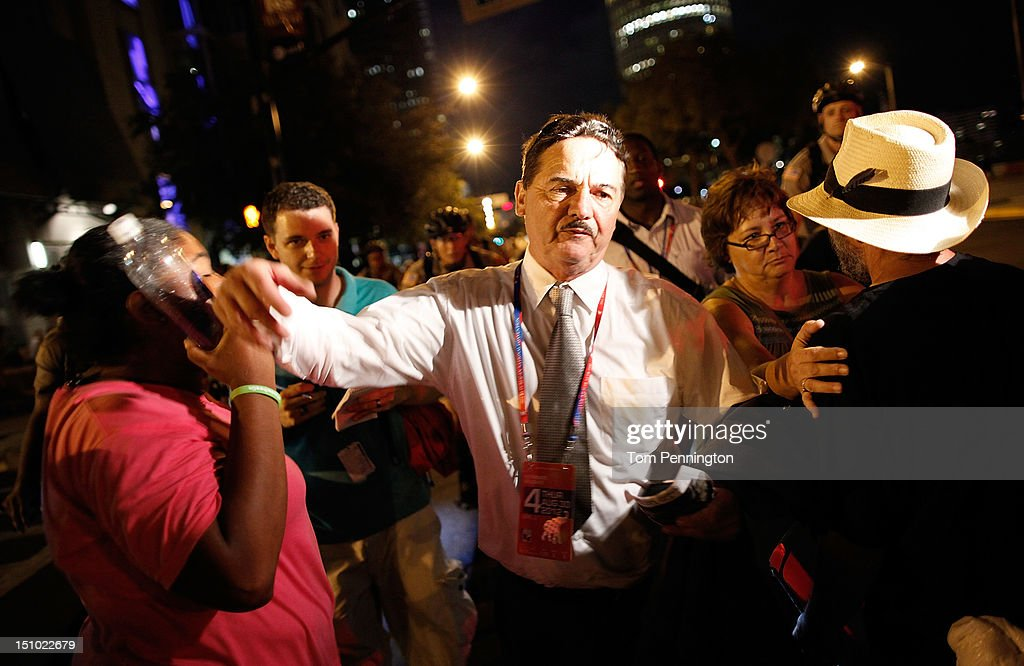 An alternate delegate at the Republican National Convention pushes his way through a crowd of protesters after being confronted by the crowd after leaving the Tampa Bay Times Forum on August 30, 2012 in Tampa, Florida. The Republican party delegates affirmed Mitt Romney as the party's nominee for president August 28.