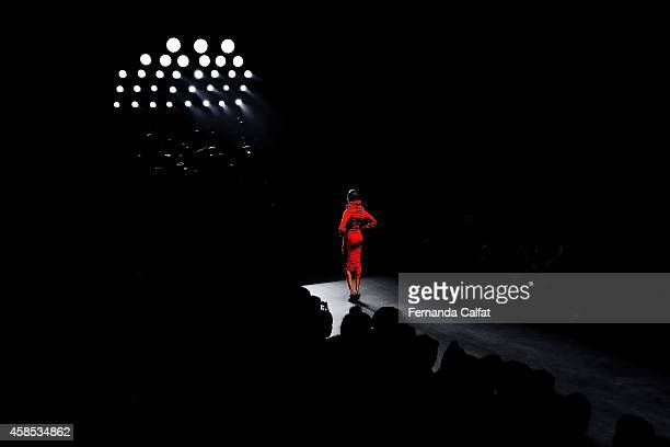 An alternate view of a model on the runway at the Lino Villaventura fashon show during Sao Paulo Fashion Week Winter 2015 at Parque Candido Portinari...