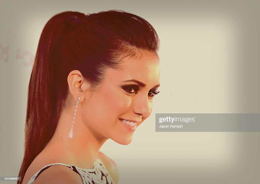 An alternate view of actress <a gi-track='captionPersonalityLinkClicked' href=/galleries/search?phrase=Nina+Dobrev&family=editorial&specificpeople=4397485 ng-click='$event.stopPropagation()'>Nina Dobrev</a> at the 21st Annual Elton John AIDS Foundation Academy Awards Viewing Party at West Hollywood Park on February 24, 2013 in West Hollywood, California.