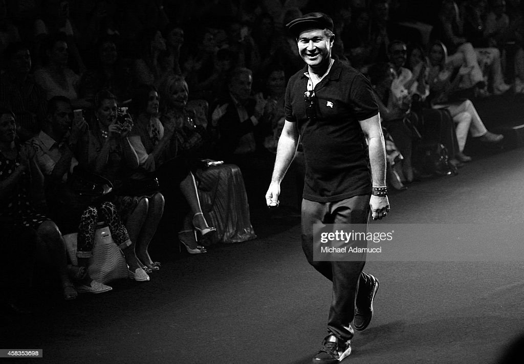 An alternate view of designer Victor Dzenk at his Victor Dzenk fashon show during Sao Paulo Fashion Week Winter 2015 at Parque Candido Portinari on...