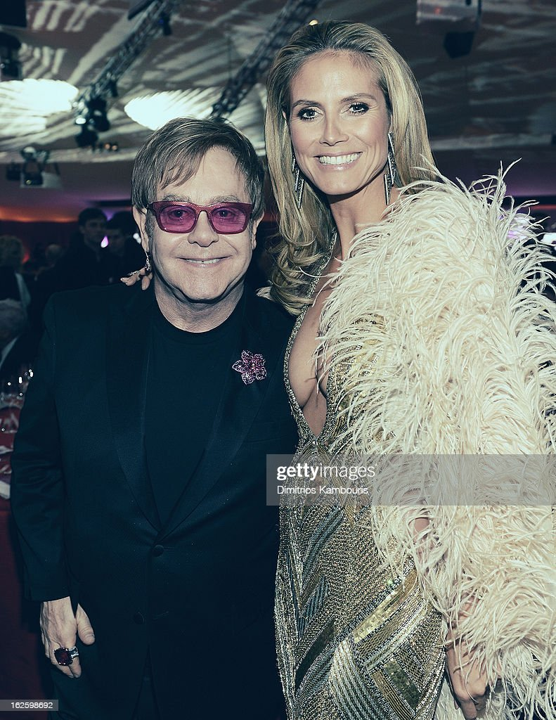 An alternate view of Sir <a gi-track='captionPersonalityLinkClicked' href=/galleries/search?phrase=Elton+John&family=editorial&specificpeople=171369 ng-click='$event.stopPropagation()'>Elton John</a> and model <a gi-track='captionPersonalityLinkClicked' href=/galleries/search?phrase=Heidi+Klum&family=editorial&specificpeople=178954 ng-click='$event.stopPropagation()'>Heidi Klum</a> at the 21st Annual <a gi-track='captionPersonalityLinkClicked' href=/galleries/search?phrase=Elton+John&family=editorial&specificpeople=171369 ng-click='$event.stopPropagation()'>Elton John</a> AIDS Foundation Academy Awards Viewing Party at West Hollywood Park on February 24, 2013 in West Hollywood, California.