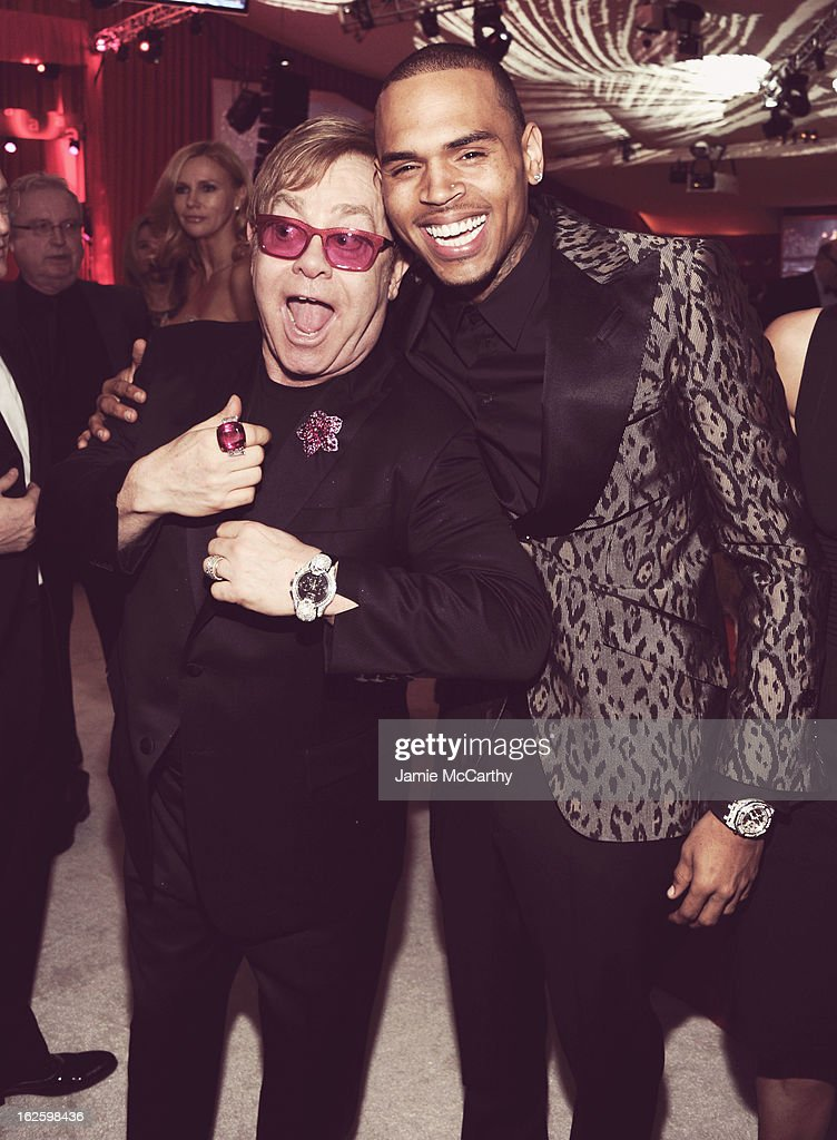 An alternate view of Sir Elton John and singer Chris Brown at the 21st Annual Elton John AIDS Foundation Academy Awards Viewing Party at West Hollywood Park on February 24, 2013 in West Hollywood, California.