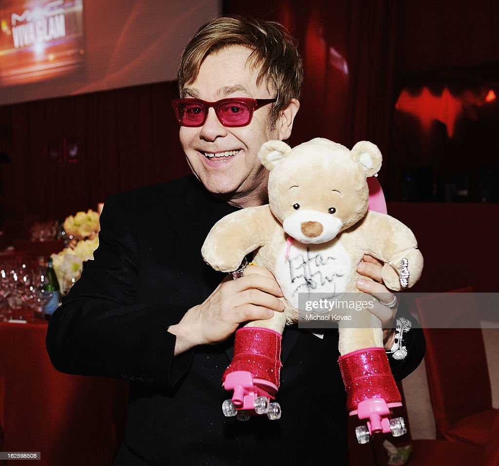 An alternate view of Sir <a gi-track='captionPersonalityLinkClicked' href=/galleries/search?phrase=Elton+John&family=editorial&specificpeople=171369 ng-click='$event.stopPropagation()'>Elton John</a> at the 21st Annual <a gi-track='captionPersonalityLinkClicked' href=/galleries/search?phrase=Elton+John&family=editorial&specificpeople=171369 ng-click='$event.stopPropagation()'>Elton John</a> AIDS Foundation Academy Awards Viewing Party at West Hollywood Park on February 24, 2013 in West Hollywood, California.