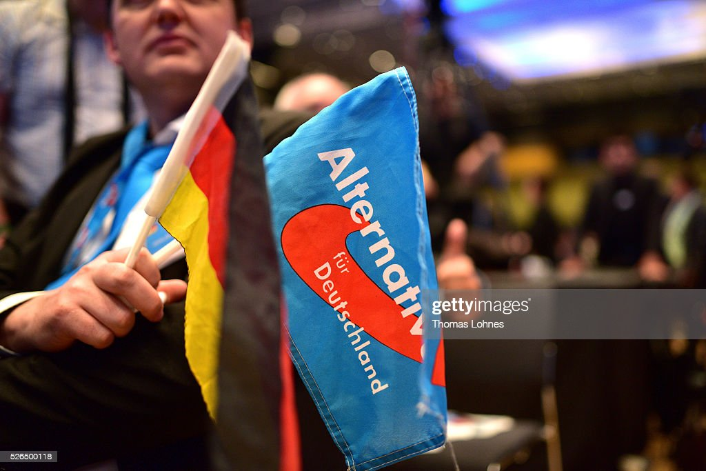 An Alternative fuer Deutschland (AfD) delegate holds a German and a AfD flag at the party's federal congress on April 30, 2016 in Stuttgart, Germany. The AfD, a relative newcomer to the German political landscape, has emerged from Euro-sceptic conservatism towards a more right-wing leaning appeal based in large part on opposition to Germany's generous refugees and migrants policy. Since winning seats in March elections in three German state parliaments the party has sharpened its tone, calling for a ban on minarets and claiming that Islam does not belong in Germany.