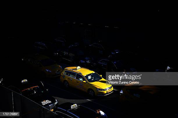An alternative view a taxi cab moves in the street as preparartions continue before the wedding of Princess Madeleine of Sweden and Christopher...