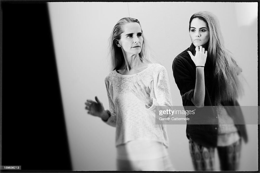 An alternative view of a model backstage ahead of A Degree Fahrenheit Presented By Mercedes-Benz And Elle Autumn/Winter 2013/14 fashion show at the Mercedes-Benz Fashion Week Berlin at the Brandenburg Gate on January 17, 2013 in Berlin, Germany.