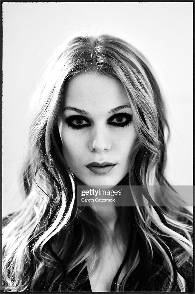 An alternative view of a model backstage ahead of the Marcel Ostertag Autumn/Winter 2013/14 fashion show at the Mercedes-Benz Fashion Week Berlin at the Brandenburg Gate on January 17, 2013 in Berlin, Germany.