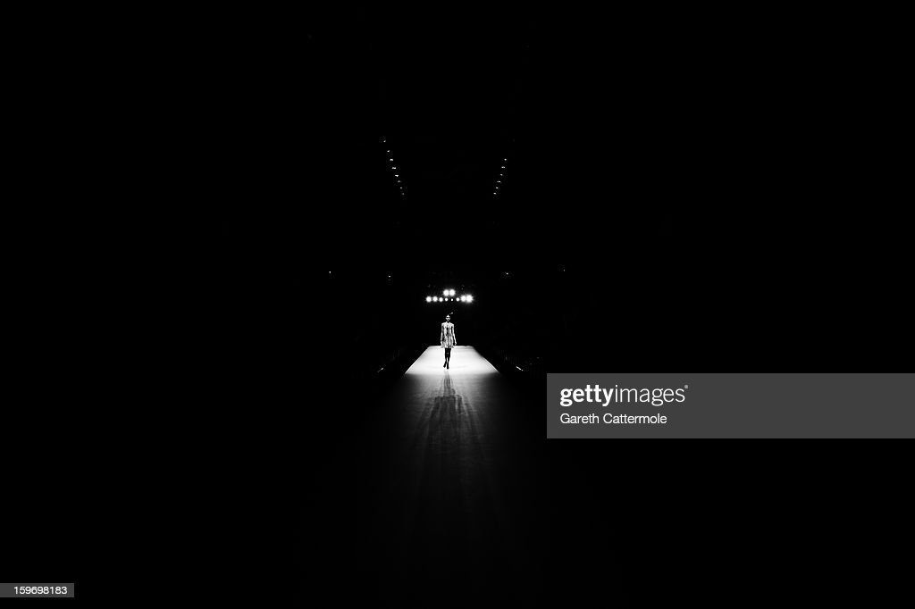 An alternative view of a model on the runway ahead of the Dawid Tomaszewski Autumn/Winter 2013/14 fashion show during the Mercedes-Benz Fashion Week Berlin at the Brandenburg Gate on January 18, 2013 in Berlin, Germany.