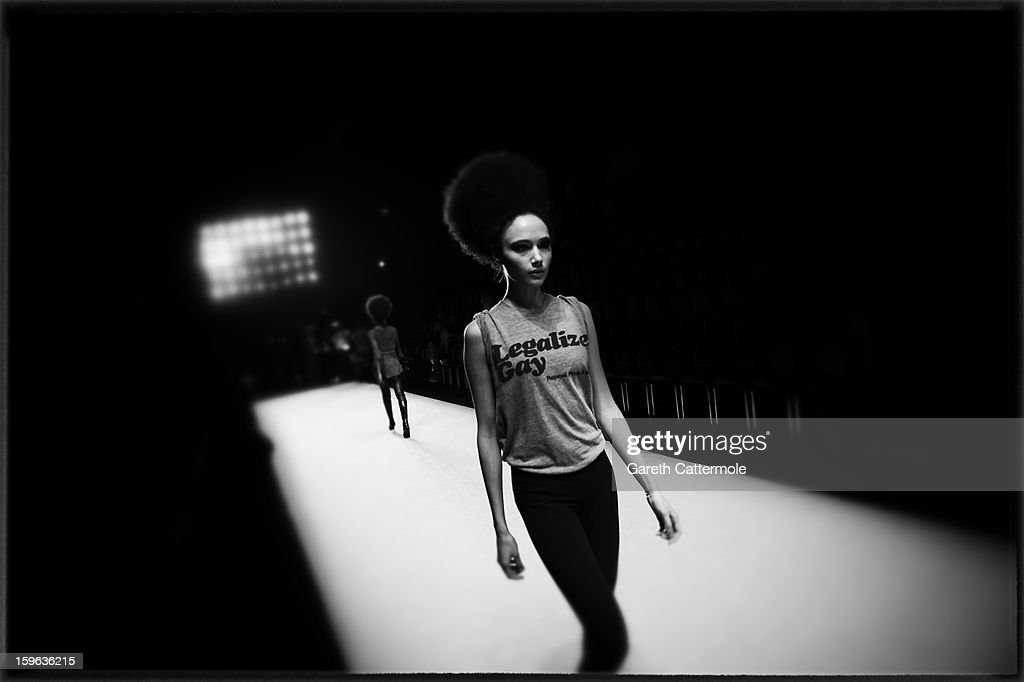An alternative view of a model prior to the Guido Maria Kretschmer Autumn/Winter 2013/14 fashion show during the Mercedes-Benz Fashion Week Berlin at the Brandenburg Gate on January 17, 2013 in Berlin, Germany.