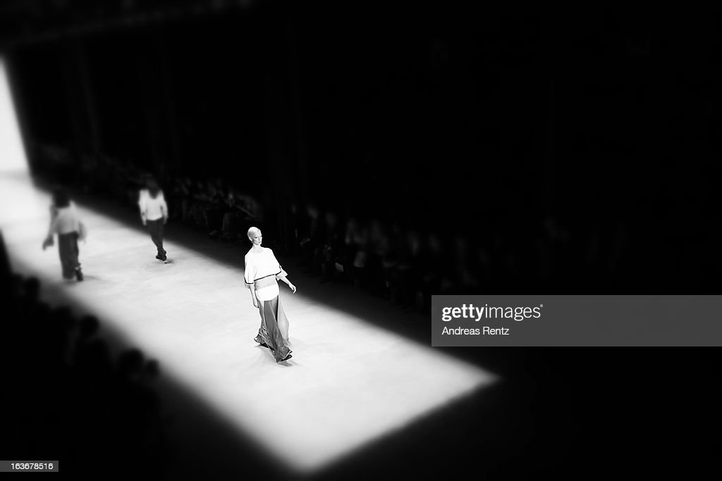 An alternative view of a model walks the runway at the Nej show during Mercedes-Benz Fashion Week Istanbul Fall/Winter 2013/14 at Antrepo 3 on March 14, 2013 in Istanbul, Turkey.