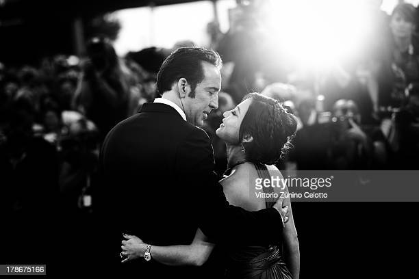 An alternative view of actor Nicolas Cage who kisses his wife Alice Kim Cage at the 'Joe' Premiere during the 70th Venice International Film Festival...