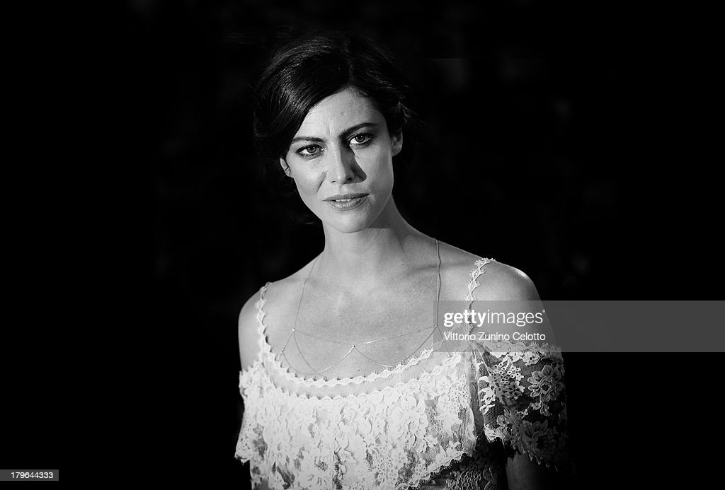 An alternative view of actress <a gi-track='captionPersonalityLinkClicked' href=/galleries/search?phrase=Anna+Mouglalis&family=editorial&specificpeople=611934 ng-click='$event.stopPropagation()'>Anna Mouglalis</a> as she attends the 'Jealousy' Premiere during the 70th Venice International Film Festival on September 5, 2013 in Venice, Italy.