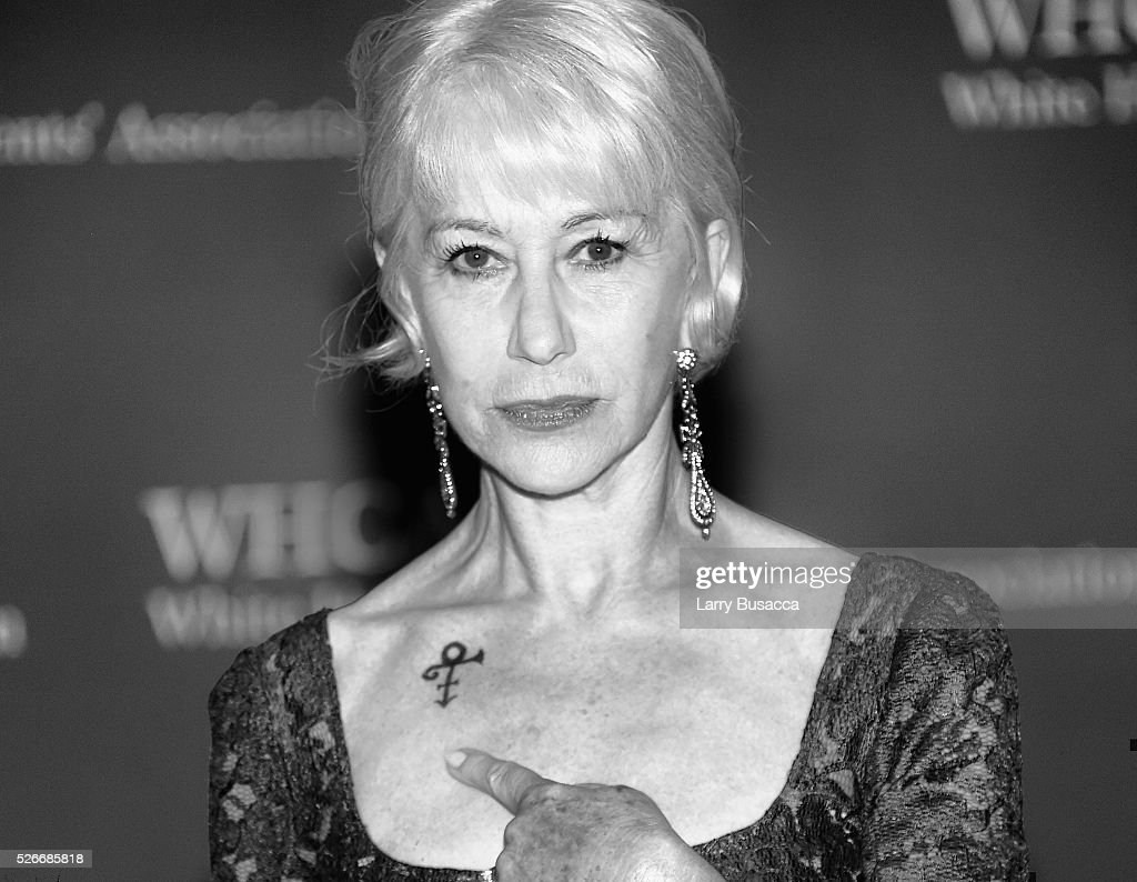 An alternative view of Actress <a gi-track='captionPersonalityLinkClicked' href=/galleries/search?phrase=Helen+Mirren&family=editorial&specificpeople=201576 ng-click='$event.stopPropagation()'>Helen Mirren</a> shows her Prince symbol tribute at at the 102nd White House Correspondents' Association Dinner Weekend on April 30, 2016 in Washington, DC.