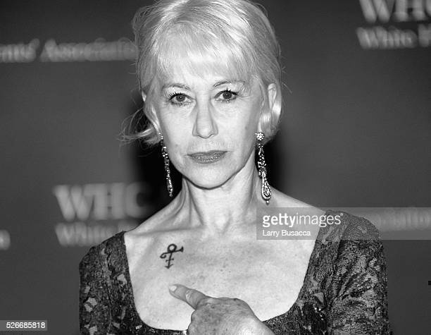An alternative view of Actress Helen Mirren shows her Prince symbol tribute at at the 102nd White House Correspondents' Association Dinner Weekend on...